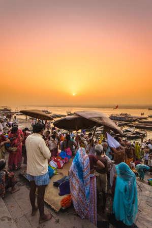 Crowd of local Indian live their morning life with Ganga river on April 18, 2010 in Varanasi, India. The most holy river of India and Hindu culture.