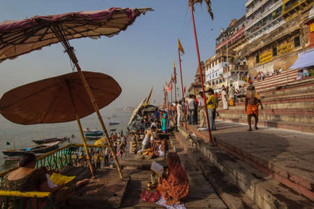 benares: Crowd of local Indian live their morning life with Ganga river on April 18, 2010 in Varanasi, India. The most holy river of India and Hindu culture.