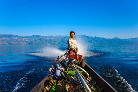 Inle, Myanmar-December 27: Local people in Inle lake usually travel by old style motor boat across the famous lake of Myanmar