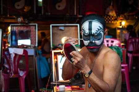 chinese opera: BANGKOK, THAILAND - JANUARY 17: A Chinese actor is doing make up before the show of traditional Chinese opera