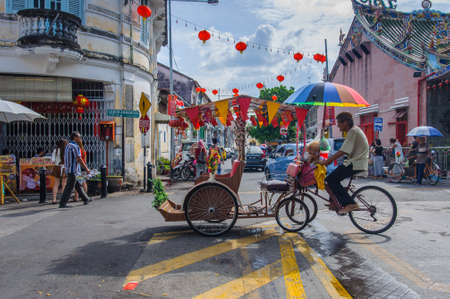 malaysia city: Georgetown, Penang, Malaysia - February 19, 2015: Classic local rickshaw in George Town, Penang, Malaysia.