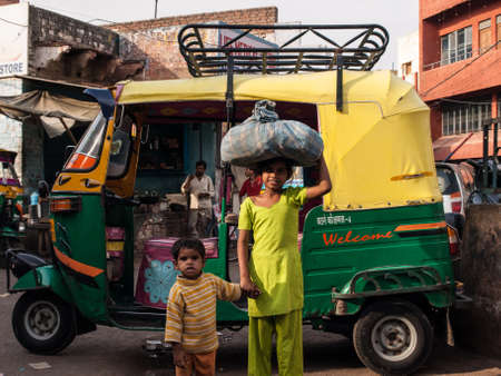 Agra, Iindia - April 17: The classical auto rickshaw is the unique vehicle style of local transportation in several Asian countries in April 17, 2009