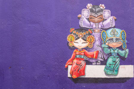 Georgetown, Penang, Malaysia - February 18, 2015: Three chinese dolls on the wall street art on wall in George Town, Penang, Malaysia.