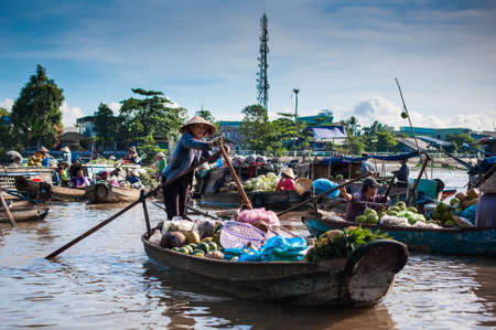 Phong Dien Floating Market, 20km from Can Tho, most famous and original floating market in Mekong Delta with local boats packed on April 14, 2012 in Can Tho, Vietnam.
