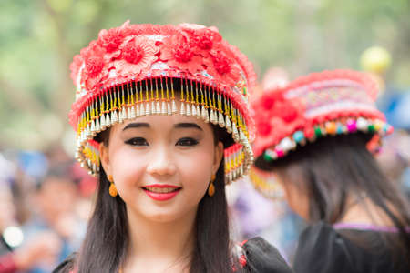 A woman of local mountaineer tribe Hmong is dressing with traditional costume in Luang Prabang, Laos.