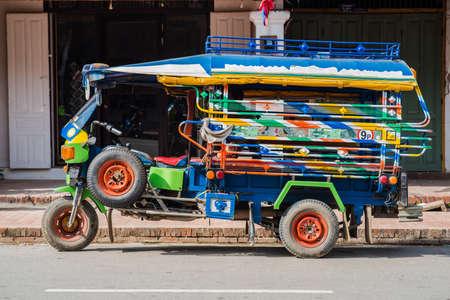 A regular auto rickshaw service in the world heritage site, Luang Prabang, Laos. Editorial