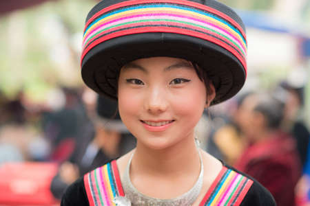 Woman of local mountaineer tribe Hmong is dressing with traditional costume in Luang Prabang, Laos.