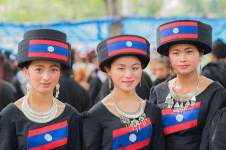 Women of local mountaineer tribe Hmong are dressing with traditional costume in Luang Prabang, Laos.
