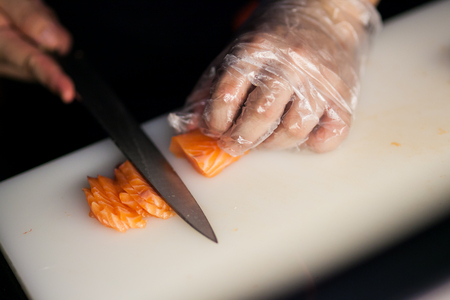 Chef slicing salmon