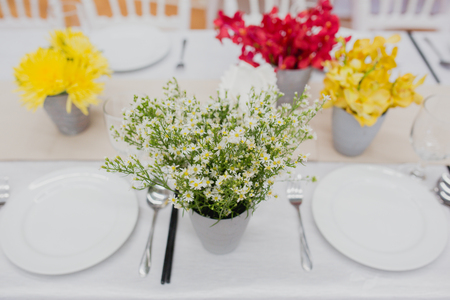 Vase of flowers set on a table wedding reception 版權商用圖片