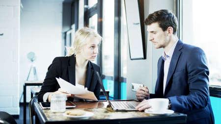 explains: Businesswoman Explains Something to Her Partner