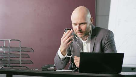Upset Businessman Having a Phone Call 写真素材