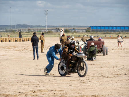 Ouistreham, France September 26, 2020 Normandy Beach Race second edition of old car and motorbike rallies on the beach, Norton motorbike with a competitor during a pandemic 에디토리얼