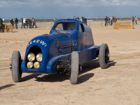 Old Renault car model on the beach of Normandy, France. Normandy Race Beach