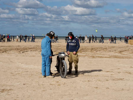 Ouistreham, France September 26, 2020 Normandy Beach Race second edition of old car and motorbike rallies on the beach, motorbike with a competitor during a pandemic