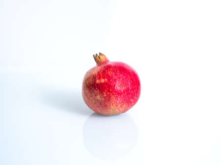 Pomegranate isolated on white background and full depth of field.