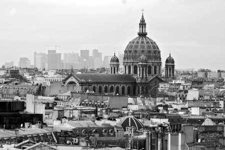 Paris cityscape with church and La Defense