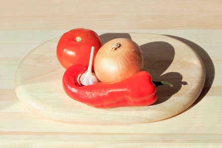 bactericidal: Pepper, tomato, onion, garlic and cutting Board on a table