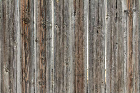 old fence: Vintage wooden gate from boards of larch with the noble gray and red tint