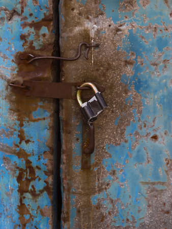 old metal door with old lock photo