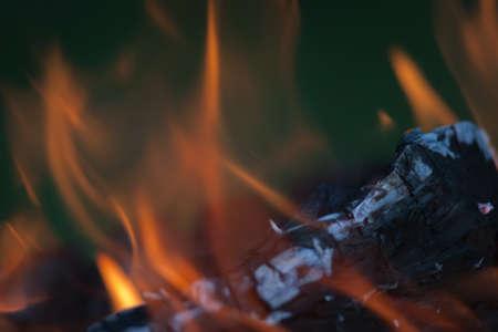 stoking: Logs Burning Stock Photo