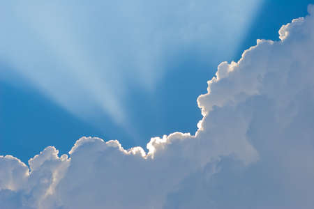 Sunshine tru beautiful white clouds on blue sky photo