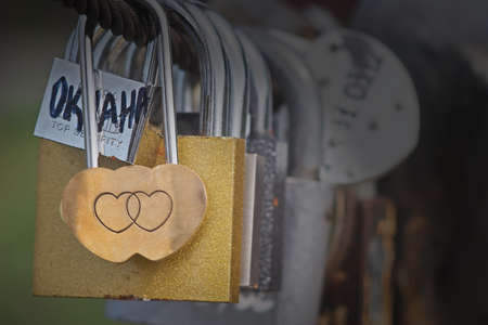 Love Padlocks a modern symbol of love and marriage attached to a bridge