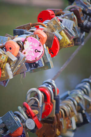Love Padlocks or Love Locks a modern symbol of love and marriage attached to a bridge Editorial