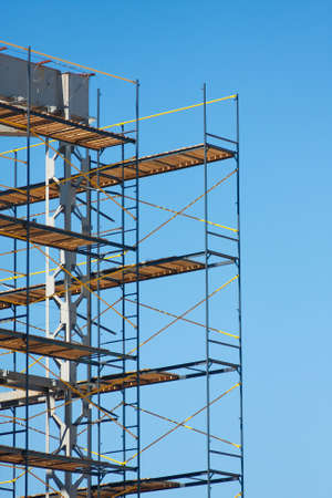 scaffolding construction with blue sky at background photo