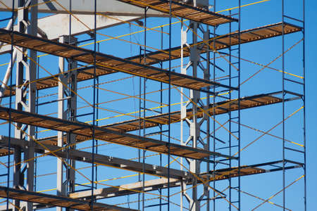 scaffold: scaffolding construction with blue sky at background