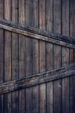 Old wooden door with planks and metal nails background photo