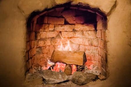 fireplace with burning wood inside nature background
