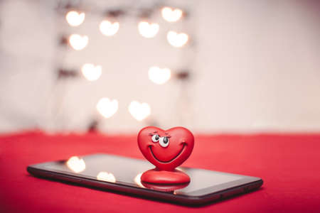 Happy red love heart with heart bokeh on the tablet PC Valentines Day  photo