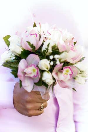 bridegrooms: wedding bouquet at bridegrooms hands. Stock Photo