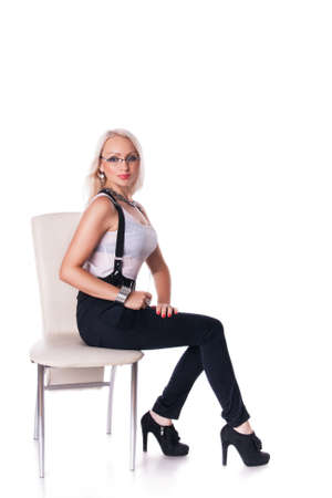 Beautiful blondy young Businesswoman sitting at the chair close up over white background photo
