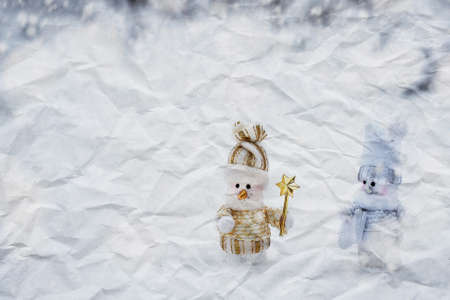 crumpled paper texture. couple of snowmen in the winter woods photo