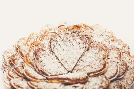 threshold: Waffle heart-shaped dusted with icing sugar macro photo Stock Photo