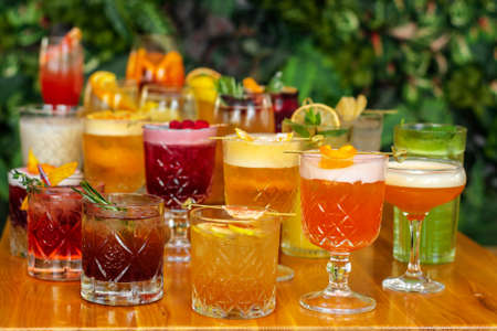 Set of alcoholic multicolor cocktails with fruits on the wooden table. Stockfoto