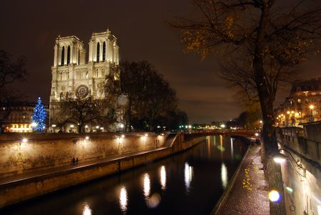 notre: Notre Dame Church over the Seine River in Paris Stock Photo