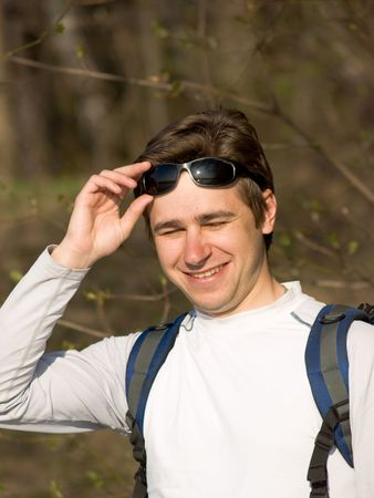 Young man with � rucksack and sun glasses