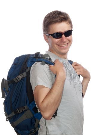 Young man with a rucksack and sun glasses