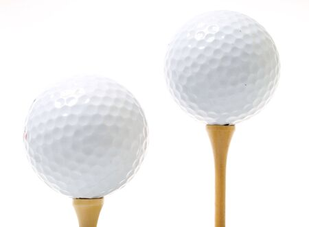 golf balls with tees isolated on white Stock Photo