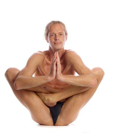 Man is making yoga isolated on white Stock Photo - 5289984