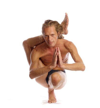 Man is making yoga isolated on white Stock Photo - 5289973