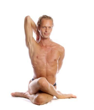 Man is making yoga isolated on white Stock Photo - 5289971