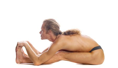 ardha: Man is making yoga isolated on white