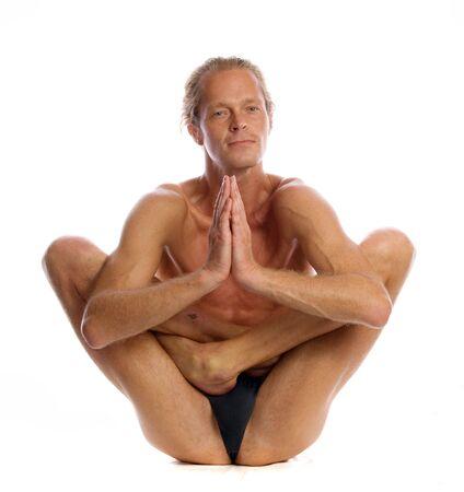 Man is making yoga isolated on white Stock Photo - 5636428
