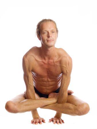 Man is making yoga isolated on white Stock Photo - 5636432