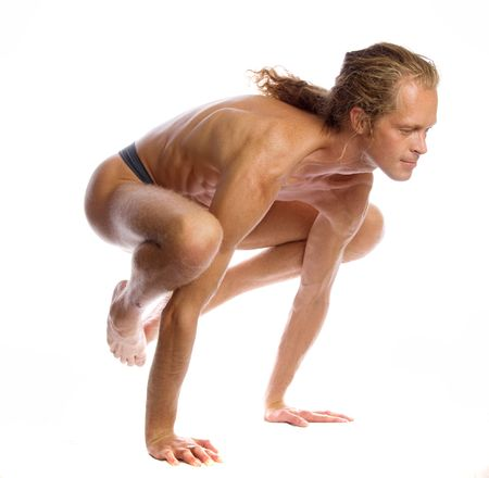 Man is making yoga isolated on white Stock Photo - 5636427