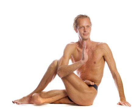 Man is making yoga isolated on white Stock Photo - 5674872